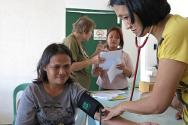Giporlos. A nurse gives a patient a check-up during a regular consultation session at the health unit. In the background is the doctor in charge, Dr Marlyn Capanang.