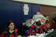Personnel of the Red Cross of Serbia register flood evacuees at a temporary shelter in Belgrade's Pionir sports hall.