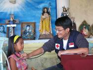 Dr Ong Chin Siang examines a patient at a mobile clinic in the half-destroyed church of Barangay Santa Rosa.