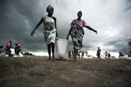 Leer, South Sudan. Women collecting sorghum and oil some hours after an airdrop conducted by the ICRC.