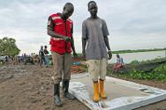A South Sudan Red Cross volunteer supervises a footbath station in the port of Kodok.