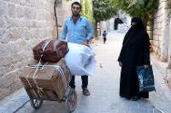 Old city, Aleppo, A man leavs his home with a few belongings in search of a safer place.