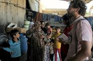 Six months after rehabilitating the water supply infrastructure at the Taamer camp for internally displaced people, Syrian Arab Red Crescent and ICRC engineers make a follow-up visit.