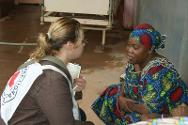 An ICRC delegate speaks to the relative of a patient operated on by the ICRC surgeon. The ICRC surgical team has been carrying out operations at Bangui Community Hospital every day since the beginning of January.