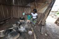 Ruth prepares food in of one of the collective kitchens next to the house she has lived in since September 2011.