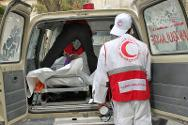 Yemen Red Crescent staff transfer bodies to Amran General Hospital.
