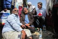 Tribal leaders sign a handover certificate during an ICRC-facilitated operation during which people held by the Al Hirak Southern Movement were exchanged for people held by the Yemeni armed forces.