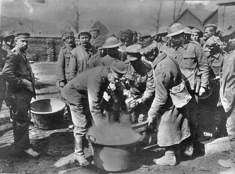 Regensburg. British prisoners of war, captured near Bapaume, waiting for a soup in a German field kitchen.