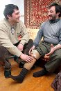 Photo, Grozny, Chechnya. An employee of the ICRC-supported prosthetic/orthotic centre visits a man who has had a leg amputed.