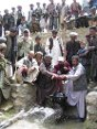 Photo, Afghanistan, Shaidan. A gate valve is opened at a ceremony to inaugurate a dam built with ICRC support.
