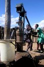 Photo, Tsholotsho district. Pupils at Tshitatshawa primary school draw water from a borehole repaired and maintained by the ICRC.