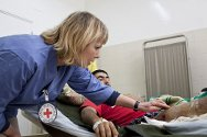 Al Jalaa Hospital, Benghazi. Tuesday, 1 March 2011. ICRC nurse Liv Raad examining the injuries of a patient shot in both legs.