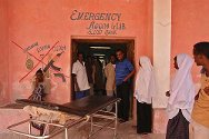 Mogadishu, Somalia. The emergency room entrance of the ICRC-supported Keysaney hospital. Paintings on the wall depict an array of weapons that are prohibited from entering the hospital (all weapons are prohibited).