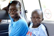 Céléstine and Mohammed sit motionless as the ICRC Land Cruiser takes them back to their village.