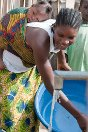 Bawaydee, Tchien District, Grand Gedeh County, Liberia. A woman collects water from a pump built by the ICRC.