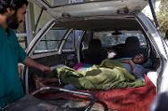 Afghanistan, 2010. Taxis are used to take people to hospital when there is no ambulance service.