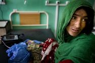 Afghanistan, 2010. It took four days for this mother to reach one of the few hospitals where her child, suffering from severe diarrhoea, could be treated. The condition of the child had worsened considerably by the time they reached the hospital.