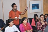 A member of the audience poses a question to the panellists during the interactive session.