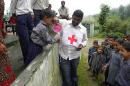 A Red Cross member promotes best hygiene practices amongst school students in Rudraprayag district, Uttrakhand.