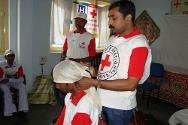 An ICRC staff member demonstrating a first-aid technique for skull injury to Red Cross volunteers in Dantewada.