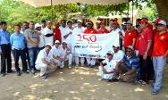 The ICRC and IFRC cricket teams get together for a photo session following a match played between the two teams to mark the Word Red Cross Day celebrations.