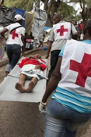 Volunteers from the Haitian Red Cross Society attending to residents of a camp in the aftermath of the earthquake that struck Port-au-Prince in 2010.