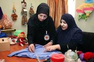 An ICRC staff member demonstrating sewing techniques during a sewing workshop for mentally challenged persons at Rashad Mental Hospital in Baghdad.
