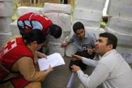 ICRC and   Jammu and Kashmir Red Cross State branch staff work together to organise medical supplies before distributing them among various city hospitals following  the curfew and strikes in Srinagar in 2010