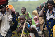 Near Goma, Democratic Republic of the Congo. Families flee the fighting.