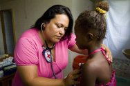 Colombia. An ICRC doctor takes care of a child.