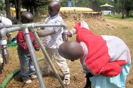 Photo, Kenya, Rift Valley. Children drinking from the tap of an ICRC-installed standpipe.