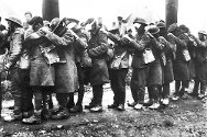 Battle of Estaire: soldiers blinded by gas standing in line at a first-aid post near Béthune, 10 April 1918.
