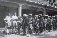 Indochina War, 1946-1954. ICRC and French Red Cross delegates speak with Vietnamese prisoners as they make their way to work at a «Seminary Camp» in Hanoi.