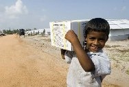 Batticaloa, Kiran IDPs camp. Child who have received ICRC hygienic kit.
