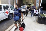 Tripoli, Libya. A cameraman is evacuated by the ICRC from the Rixos Hotel on 24 August 2011.