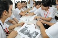 Nanjing, China. Young people taking part in an interactive Exploring Humanitarian Law activity as part of a Red Cross Society of China summer camp