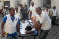 Madagascar. Malagasy Red Cross volunteers carry a casualty at a first aid post.
