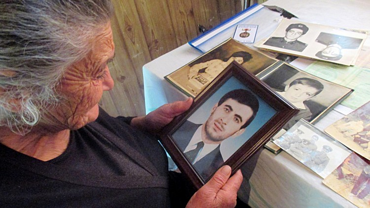 Georgia: Finding dead son's remains ends ambiguity for mother