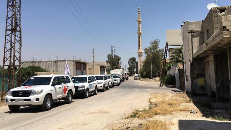 叙利亚:救援车队在进入被困城镇达拉亚遭拒后打道回府