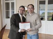 One of the training course's 32 participants, Professor Wei (right) from China University of Political Science and Law.