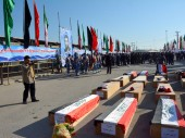 Shalamcha border crossing, Iraq. Remains of Iraqi soldiers await repatriation in coffins wrapped in their national flag.