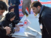 Shalamcha border crossing, Iraq. ICRC staff participate in the handing over of the remains.
