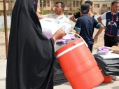 Al Ghazaliah, Baghdad. Food and relief items are distributed to people forced to flee Ramadi.©ICRC/L. Sabri