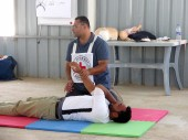Jordan, Mafraq. ICRC delegate gives first aid training to Syrian refugees at the Zaatari camp.