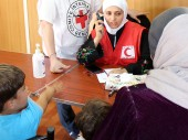 Mafraq. With Jordan Red Crescent Society volunteers, the ICRC helps Syrian refugees maintain contact with family members