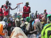South Sudan Red Cross volunteers explain to the community how to prepare Super Cereal.
