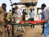 A wounded person is about to be loaded onto an ICRC plane for transport to a regional hospital on May 26, 2015.