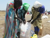 South Sudan. Women collect food rations during an ICRC distribution.