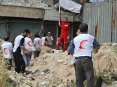 SARC and ICRC teams deliver emergency aid across front lines in Aleppo.