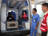 A sick Syrian refugee is transferred from the ICRC-run medical facility at Raba'a Al Sarhan Registration Centre in Mafraq.